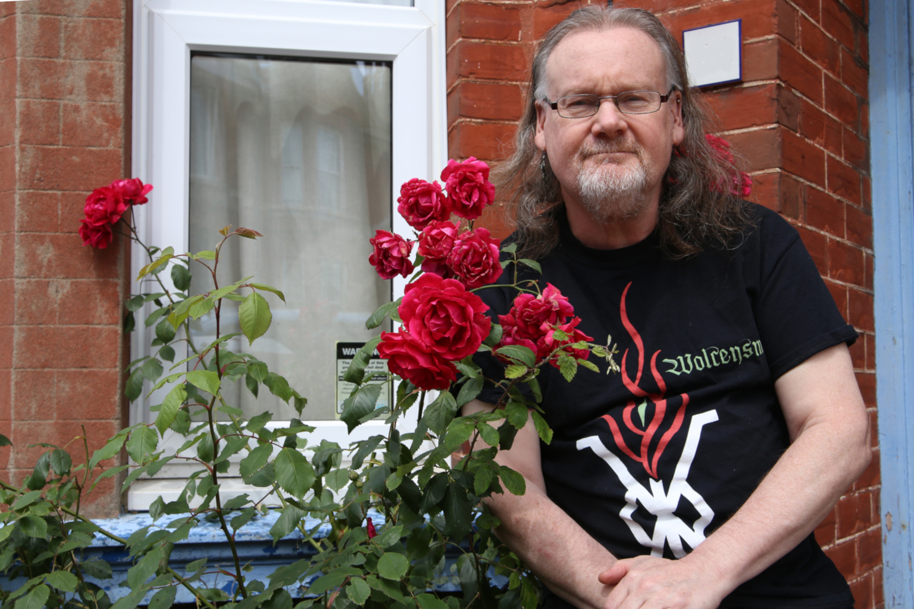 Longhaired man with roses