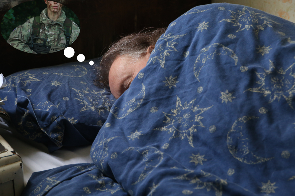 Man in bed. Dream bubble showing soldier.
